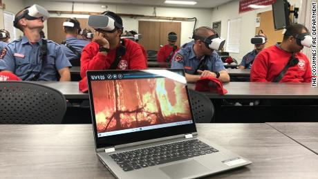 Firefighter trainees from the Cosumnes Fire Department are taught how to handle specific scenarios while wearing VR headsets.