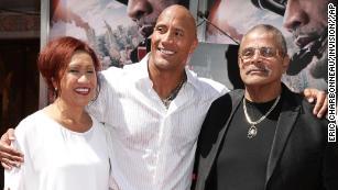 Ata Johnson, Dwayne Johnson and Rocky Johnson in 2015.