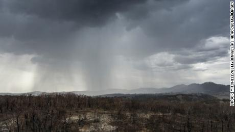 Rain falls on drought and fire-ravaged country near the city of Tamworth, New South Wales.