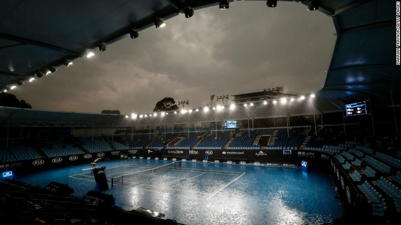 Heavy rain falls ahead of the 2020 Australian Open at Melbourne Park on January 15, 2020.