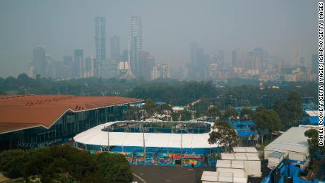 Smoke hangs over Melbourne during qualifying for the Australian Open.