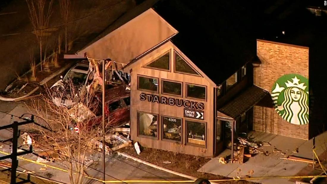 Part of a Starbucks collapses after a truck hits it