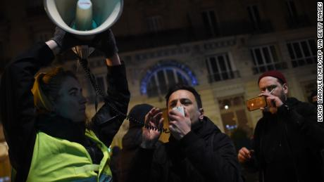 A protestor speaks in a megaphone during a demonstration in front of the Bouffes du Nord theatre in Paris on January 17, 2020 as French President attends a play. - Protestors demonstrate against French President policy including the pension reform. (Photo by Lucas BARIOULET / AFP) (Photo by LUCAS BARIOULET/AFP via Getty Images)