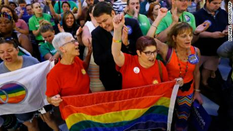Same-sex marriage supporters cheer at the Statehouse in Indianapolis after the Supreme Court declared that same-sex couples have a right to marry anywhere in the United States on June 26, 2015.