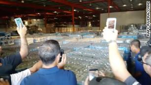 A warehouse filled with bottled water and emergency supplies was opened Saturday by residents in Ponce, Puerto Rico.