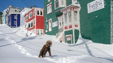 A resident struggles through the snow in St. John's, Newfoundland, on Saturday.