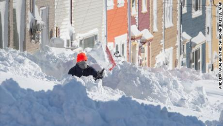 A resident digs out his walkway in St. John's, Newfoundland, on Saturday.