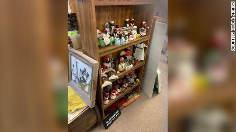 """The Jim Crow era signs were placed next to a number of """"Mammy"""" dolls."""