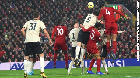 Virgil van Dijk rises highest to give Liverpool the lead.