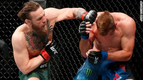 "Conor McGregor hits Donald ""Cowboy"" Cerrone during UFC 246."