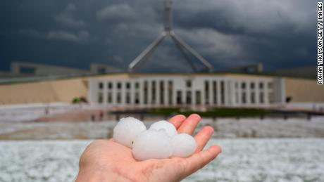 Dust storms and golf ball-sized hail are battering southeastern Australia