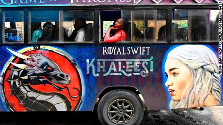 "A woman looks on as she is sitting in a matatu-(passenger mini bus) bearing a grafitti of ""Game of Thrones"" series, in Nairobi's Luthuli Avenue at the heart of the city, on May 22, 2019. (Photo by SIMON MAINA / AFP)        (Photo credit should read SIMON MAINA/AFP via Getty Images)"