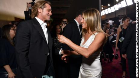 Exes Brad Pitt (left) and Jennifer Aniston share a moment at the 26th Annual Screen Actors Guild Awards at The Shrine Auditorium on January 19 in Los Angeles.