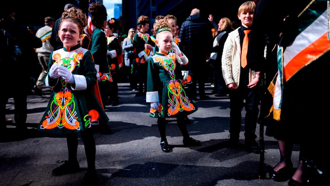 <strong>New York:</strong> Dancing girls wait to perform on 5th Avenue passing the St Patrick's Cathedral in 2019.