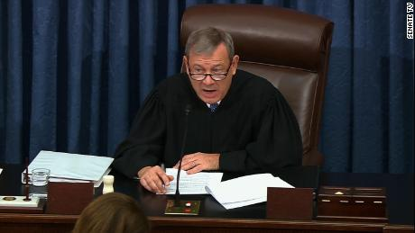 John Roberts watches as senators debate whether he can intervene in the impeachment trial