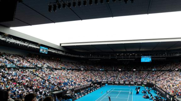 A packed Rod Laver Arena looks on as Roger Federer gets his campaign underway against Steve Johnson. Federer has won here six times -- one fewer than Djokovic.