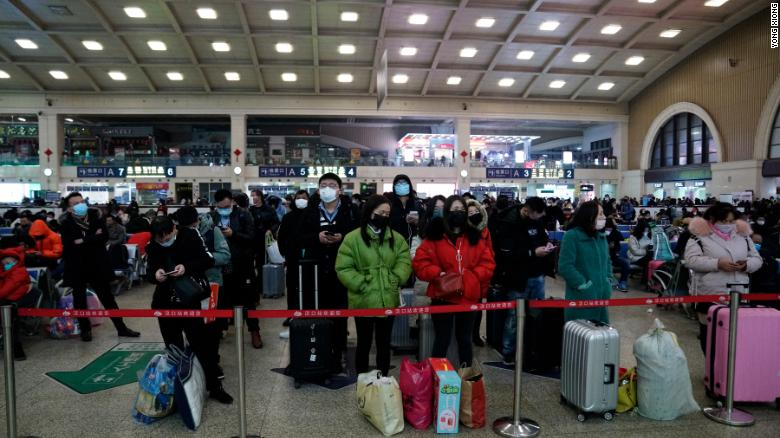 Travelers at Wuhan's Hankou railway station queue to leave the city early on Thursday morning before the citywide lockdown came into effect.