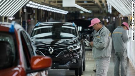 Global carmakers and luxury brands hit as virus shuts down China's 'motor city'