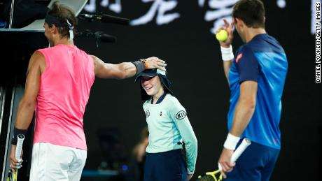 Nadal checks to see if the ball kid is OK after she was struck by a ball.