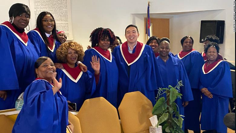 Yang posing with choir members for a photo last Sunday.