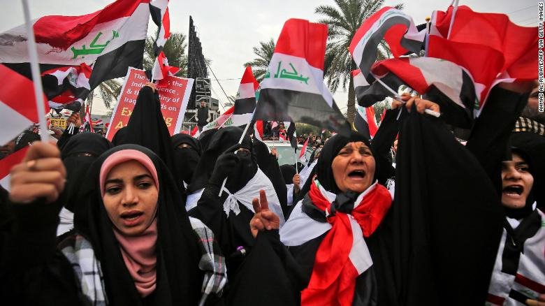Women shout slogans at the protest in Baghdad against the US military presence in Iraq.