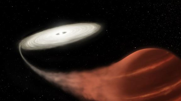 A white dwarf, left, is pulling material off of
