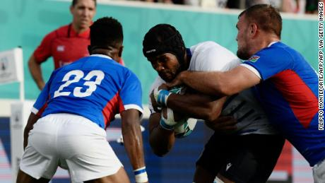 Mbanda is tackled during the Rugby World Cup match between Italy and Namibia.