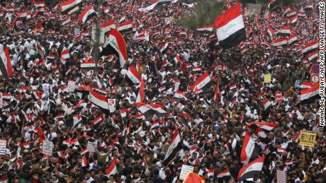 Hundreds of thousands of Iraqis, waving national flags, take to the streets in central Baghdad on January 24, 2020.