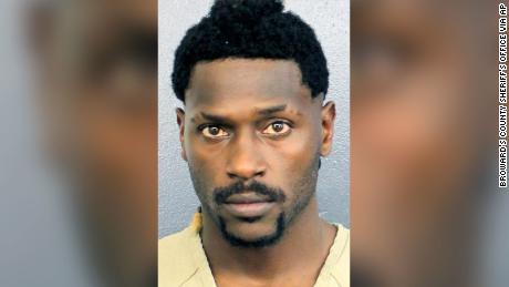 Antonio Brown turned himself in at a Florida jail on Thursday night, following accusations that he and his trainer attacked the driver of a moving truck.