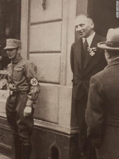 The notorious 1933 image shows Richard Stern, center, wearing his Iron Cross while a young Nazi guards the store.
