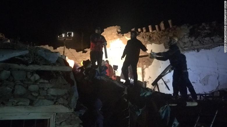 Teams conduct search operations for survivors of a collapsed building in Malatya province.