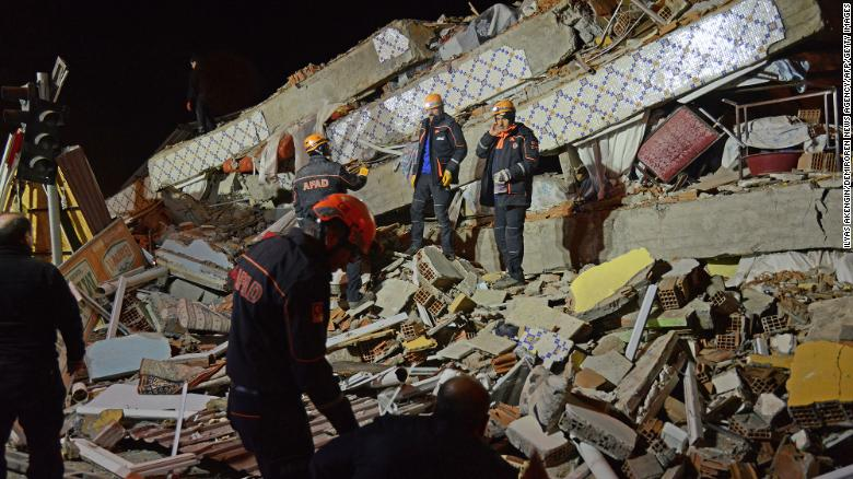 Turkish rescue and police work at the scene of a collapsed building following a 6.8 magnitude earthquake in Elazig, eastern Turkey on January 24, 2020.
