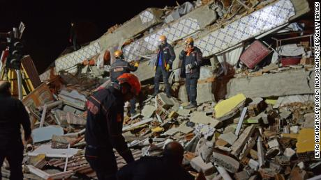 Turkish rescue and police work at the scene of a collapsed building in Elazig following a 6.8 magnitude earthquake in eastern Turkey, on January 24, 2020.