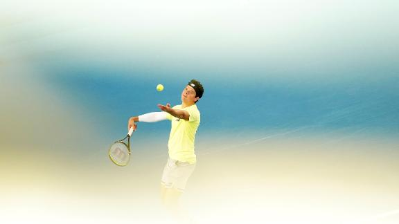 Milos Raonic prepares to serve in his third round match against Greece