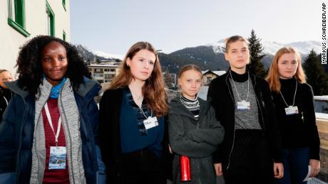 Climate activists Vanessa Nakate, Luisa Neubauer, Greta Thunberg, Isabelle Axelsson and Loukina Tille, from left, arrive for a news conference in Davos. The AP news agency apologized for earlier publishing an image with Nakate cropped out.