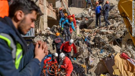 Rescue workers search through the rubble in Elazig Saturday.