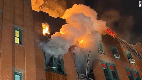 At least 200 New York City firefighters battled the raging blaze at the building in the city's Chinatown area Thursday night.