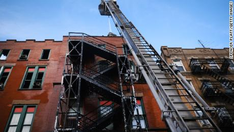Firefighters continue to work in New York's Chinatown on Friday after a fire Thursday evening severely damaged a historic building that has been home to a museum, a senior center and other nonprofits for decades.