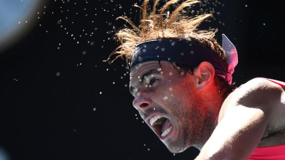 Rafael Nadal hits a serve against fellow Spaniard Pablo Carreno Busta during their singles match-up, which Nadal won.