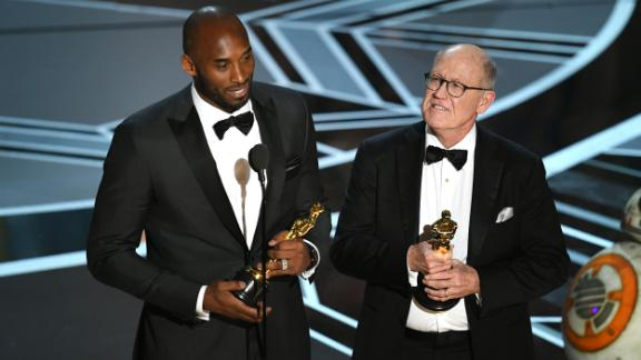 "Bryant and filmmaker Glen Keane accept the 2018 Oscar for best animated short film. ""Dear Basketball"" was based on a letter Bryant wrote in 2015 announcing his retirement from basketball."
