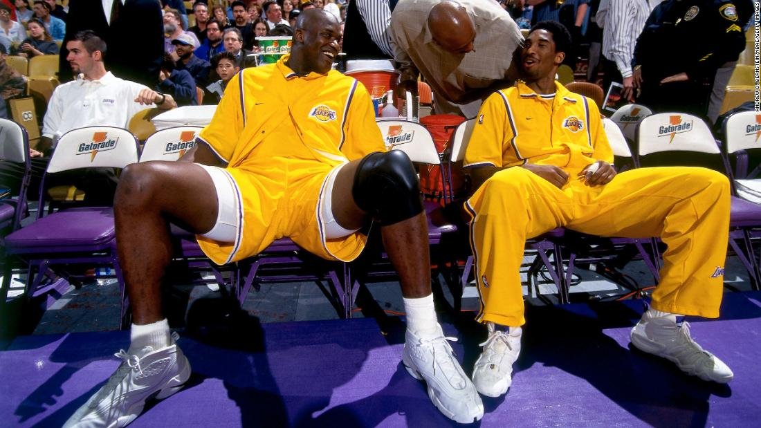 Shaquille O'Neal and Byrant sit on the bench before a game in 1999 at the Staples Center in Los Angeles.