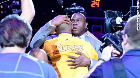 Earvin 'Magic' Johnson hugs Kobe Bryant #24 of the Los Angeles Lakers before a game against the Utah Jazz in April 2016.