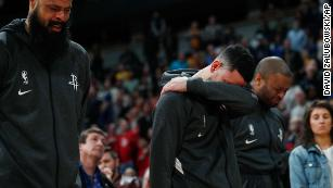 From left, Houston Rockets players Tyson Chandler, Austin Rivers and P.J. Tucker react during a tribute to Kobe Bryant before their game against the Denver Nuggets on Sunday,  January 26.