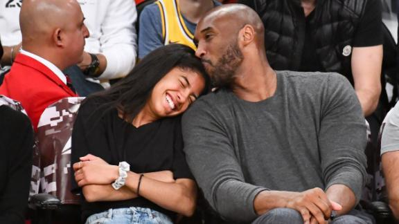 Bryant and his daughter Gianna attend a Los Angeles Lakers game against the Atlanta Hawks in 2019.