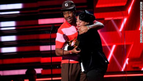 Tyler, the Creator and his mother accept the Best Rap Album award at the Grammys. (Photo by Kevork Djansezian/Getty Images)