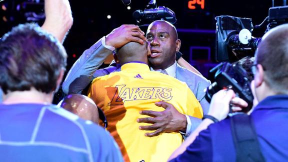 Magic Johnson hugs Bryant before the final game of his career in 2016.