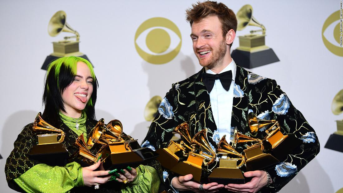 "Billie Eilish and her brother and producer Finneas O'Connell pose in the press room with their awards for Album of the Year, Record of the Year, Best New Artist, Song of the Year and Best Pop Vocal Album after the 62nd Annual Grammy Awards on Sunday, January 26. <a href=""https://www.cnn.com/2020/01/27/entertainment/billie-eilish-grammys/index.html"" target=""_blank"">The 18-year-old stole the night after sweeping the four biggest prizes.</a>"