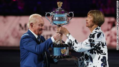 Margaret Court is presented with a replica trophy at the 2020 Australian Open.