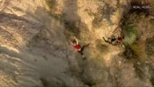 Woman rescued from cliff