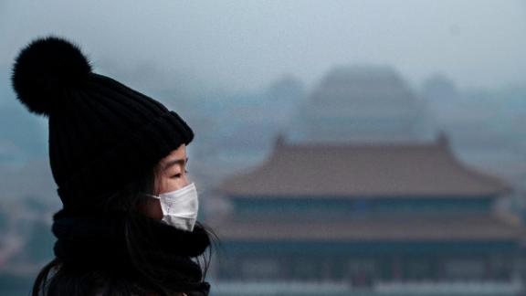 BEIJING, CHINA - JANUARY 26: A Chinese girl wears a protective mask as she stands on an overlook towards the Forbidden City, which was closed by authorities, during the Chinese New Year holiday  on January 26, 2020 in Beijing, China. The number of cases of a deadly new coronavirus rose to over 2000 in mainland China Sunday as health officials locked down the city of Wuhan earlier in the week in an effort to contain the spread of the pneumonia-like disease. Medical experts have confirmed the virus can be passed from human to human. In an unprecedented move, Chinese authorities put travel restrictions on the city which is the epicenter of the virus, and neighboring municipalities affecting tens of millions of people. The number of those who have died from the virus in China climbed to at least 56 on Sunday, and cases have been reported in other countries including the United States, Canada, Australia, France, Thailand, Japan, Taiwan and South Korea. (Photo by Kevin Frayer/Getty Images)